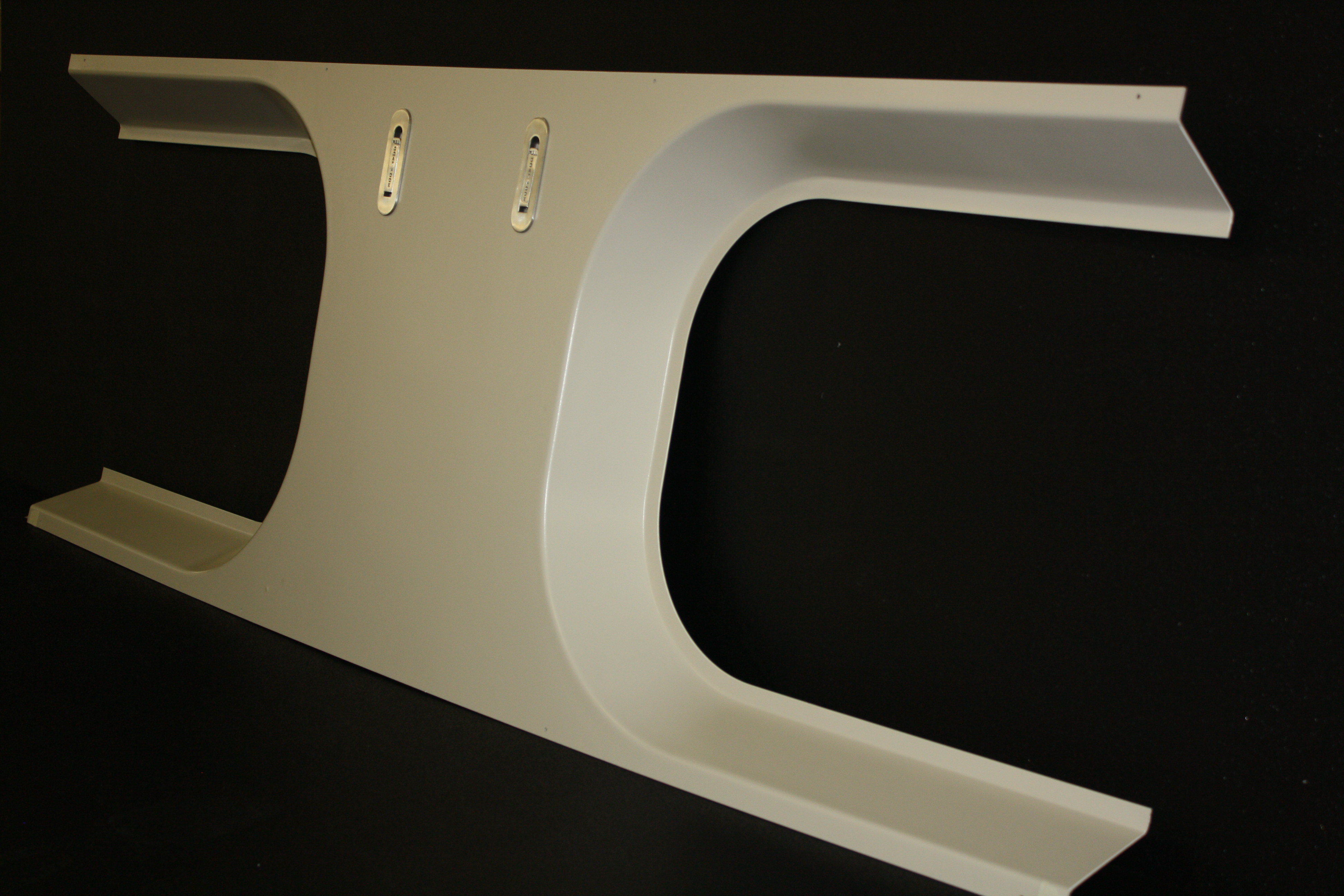 The components pictured here, and above, are window masks being produced for Chicago's Metra commuter rail system.